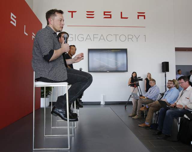 Elon Musk, CEO of Tesla Motors Inc., left, discusses the company's new Gigafactory Tuesday, July 26, 2016, in Sparks, Nev. It's Tesla Motors biggest bet yet: a massive, $5 billion factory in the N ...