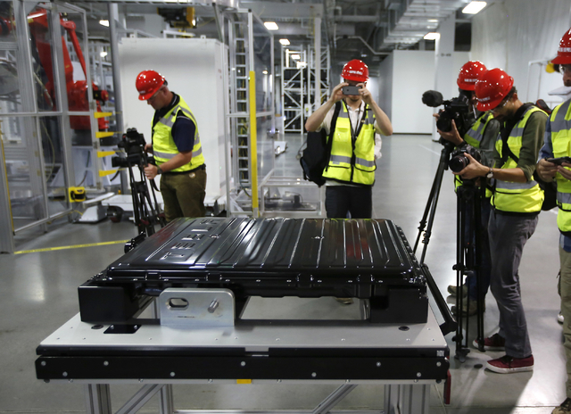 A Tesla battery pack is displayed during a media tour of the new Tesla Motors Inc., Gigafactory Tuesday, July 26, 2016, in Sparks, Nev. It's Tesla Motors biggest bet yet: a massive, $5 billion fac ...