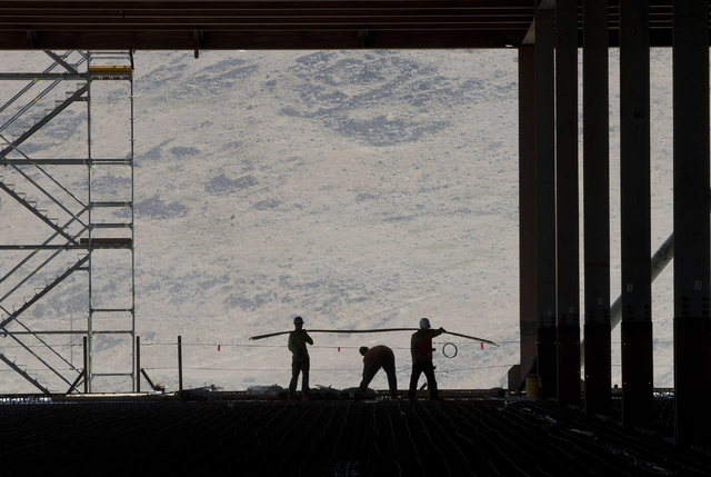Construction workers are seen in the through uncompleted D section of new Tesla Motors Inc., Gigafactory, Tuesday, July 26, 2016, in Sparks, Nev. It's Tesla Motors biggest bet yet: a massive, $5 b ...