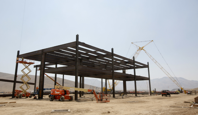 The steel frame is seen under construction at the new Tesla Motors Inc., Gigafactory, Tuesday, July 26, 2016, in Sparks, Nev. It's Tesla Motors biggest bet yet: a massive, $5 billion factory in th ...