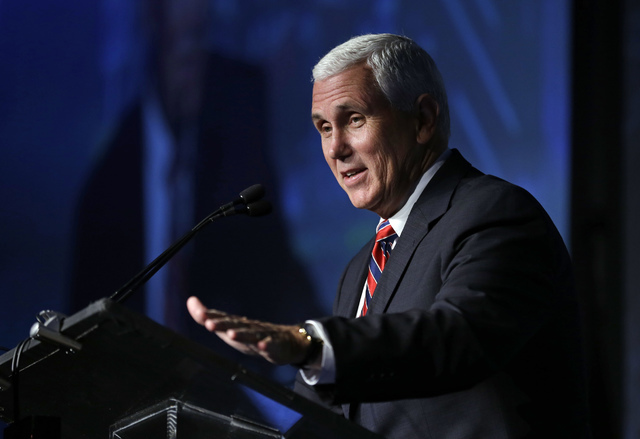 Indiana Gov. Mike Pence speaks at the American Legislative Exchange Council annual meeting in Indianapolis, Friday, July 29, 2016. (Michael Conroy/The Associated Pres)