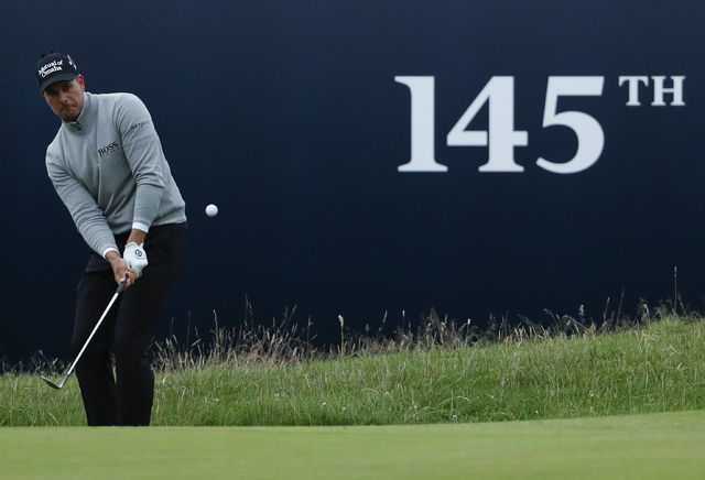 Henrik Stenson of Sweden chips onto the 18th green during the third round of the British Open Golf Championship at the Royal Troon Golf Club in Troon, Scotland, Saturday, July 16, 2016. (Ben Curti ...