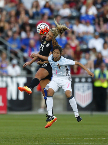 U.S. midfielder Allie Long (23) and Japan midfielder Emi Nakajima (7) go up for a header during the first half of an international friendly soccer match Thursday, June 2, 2016, in Commerce City, C ...