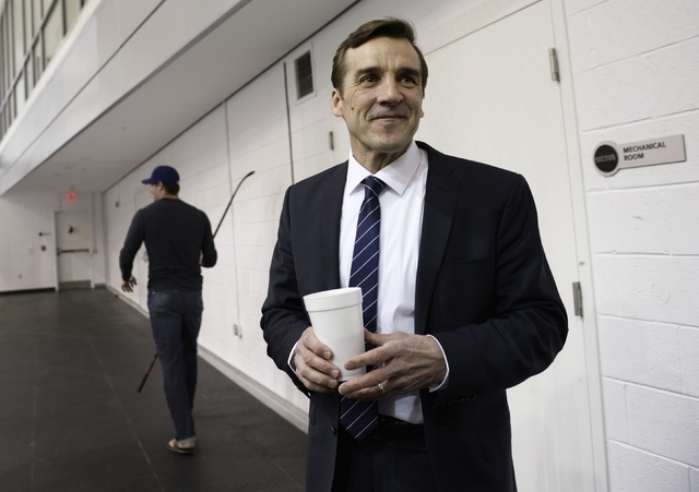 Washington Capitals former general manager George McPhee, right, stands after talking with Washington Capitals player Troy Brouwer, in Arlington, Va., Monday, April 28, 2014. McPhee, who had just  ...