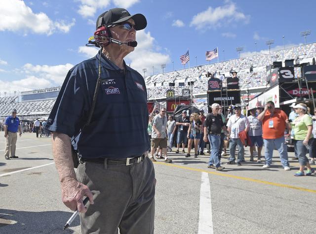 Team owner Joe Gibbs walks through the garage area at Daytona International Speedway in Daytona Beach, Fla., on Saturday, Feb. 20, 2016. (Phelan M. Ebenhack/The Associated Press)