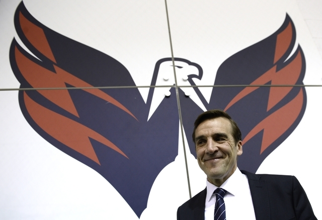 Washington Capitals former general manager George McPhee walks away from the podium after a news conference in Arlington, Va., Monday, April 28, 2014. (AP Photo)