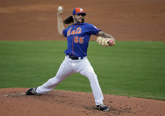 Robert Gsellman throws during a spring training game in this file photo. (Jeff Roberson/AP)