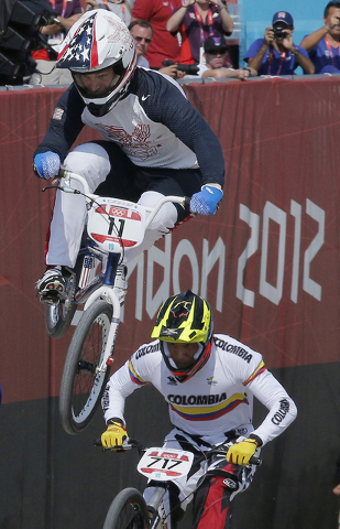 Connor Fields of the United States takes a jump in a BMX cycling men's quarterfinal run during the 2012 Summer Olympics in London, Thursday, Aug. 9, 2012. (Christophe Ena/AP)