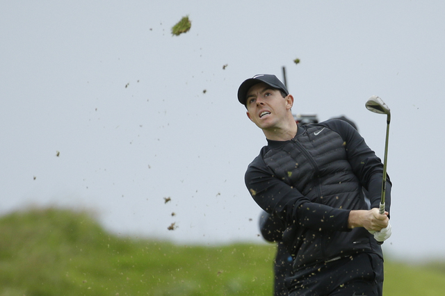 Rory McIlroy of Northern Ireland hits a shot from the 3rd fairway during the third round of the British Open Golf Championship at the Royal Troon Golf Club in Troon, Scotland, Saturday, July 16, 2 ...