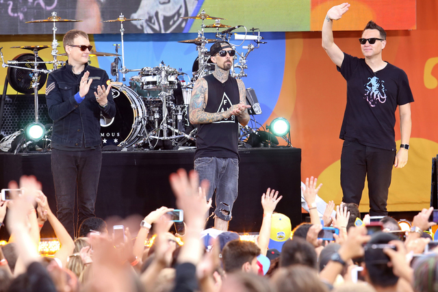 "Matt Skiba, Travis Barker and Mark Hoppus of Blink-182 perform on ABC's ""Good Morning America"" at Rumsey Playfield/SummerStage on July 1, 2016, in New York. (Greg Allen/Invision/AP)"