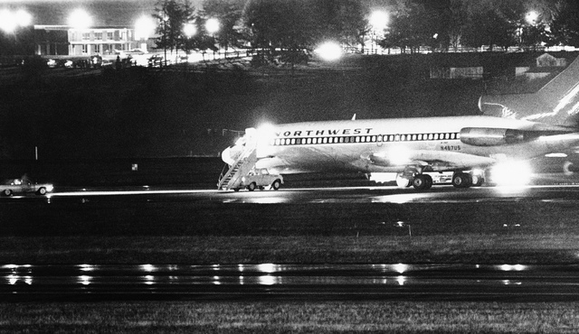 A hijacked Northwest Airlines jetliner is seen in this Nov. 25, 1971, file photo as it sits on a runway for refueling at Seattle-Tacoma International Airport, Nov. 25, 1971, Seattle. D.B. Cooper,  ...