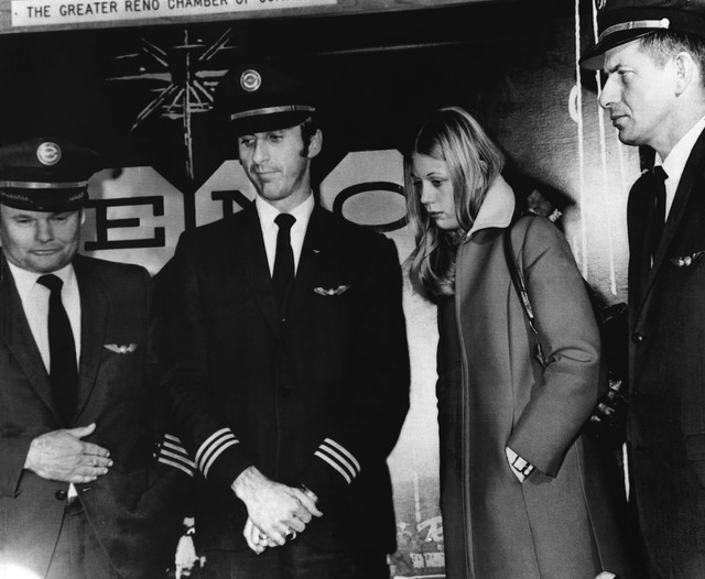 Crew members from a Northwest Airlines jet, hijacked Nov. 24, 1971, is seen in this Nov. 25, 1971, file photo as they appear at a news conference at the Reno International Airport, about two and a ...