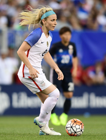 United States defender Julie Johnston dribbles the ball during the second half of an international friendly soccer match against Japan, Sunday, June 5, 2016, in Cleveland, Ohio. (David Dermer/AP)