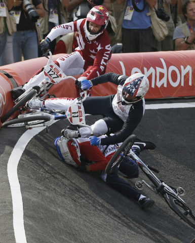 United States' Connor Fields  (11) crashes during a a BMX cycling men's semifinal run during the 2012 Summer Olympics, Aug. 10, 2012, in London. (Matt Rourke/AP)