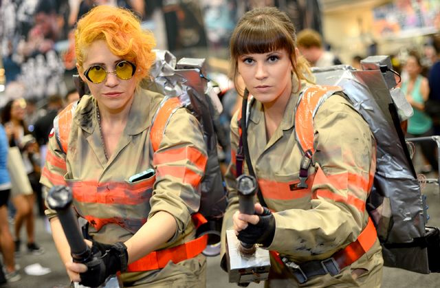 "Sara Maldonadao, of Denver, left, and Alison Sumo, of Placentia, Calif., dress as characters from the film, ""Ghostbusters"" on day 2 of Comic-Con International on Friday, July 22, ..."