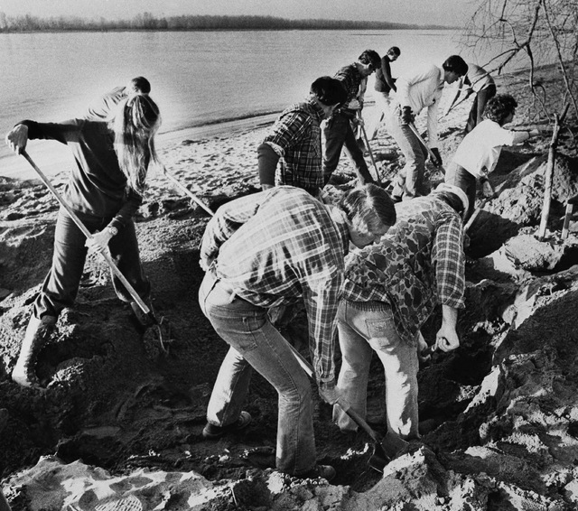FBI agents scour the sand of a beach on the Columbia River in this Feb. 13, 1980, file photo, searching for additional money or clues in the D.B. Cooper skyjacking case, in Vancouver, Washington.  ...