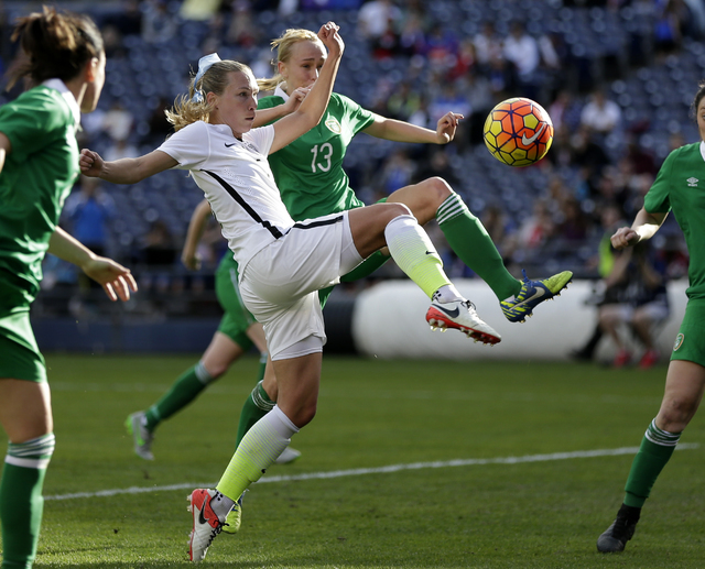 The United State's Whitney Engen, center left, shoots on goal as Ireland's Stephanie Roche (13) defends during the first half in a women's international friendly soccer game Saturday, Jan. 23, 201 ...
