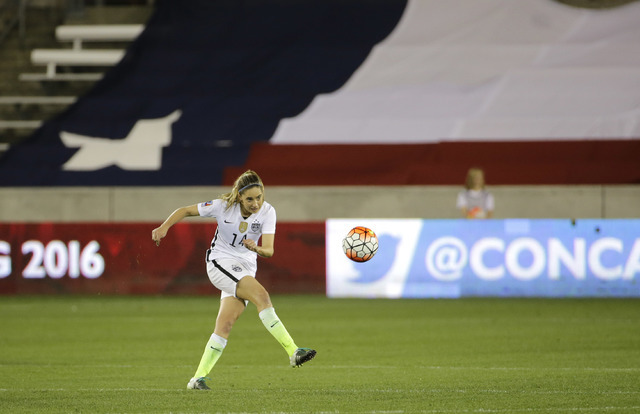 United States Morgan Brian (14) advances the ball against Trinidad and Tobago during the second half of a CONCACAF Olympic women's soccer qualifying championship semifinal Friday, Feb. 19, 2016, i ...