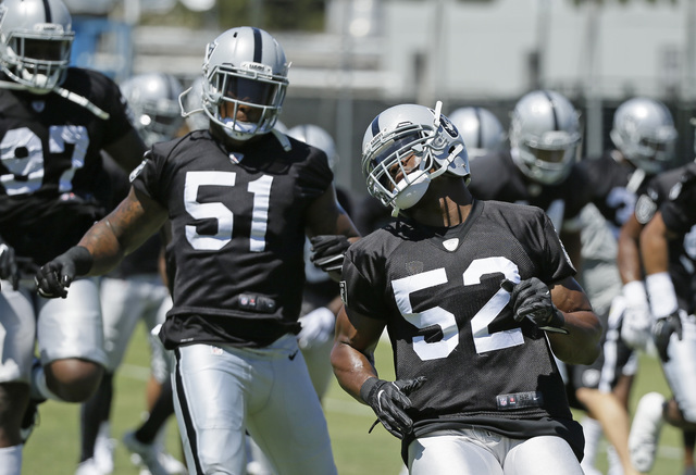 Oakland Raiders defensive end Khalil Mack (52) and Oakland Raiders linebacker Bruce Irvin (51) during practice at the NFL football team's training camp Friday, July 29, 2016, in Napa, Calif. (AP P ...