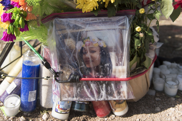 A memorial for Phoukeo Dej-Oudom, one of the victims of Wednesday night's quadruple murder-suicide, is seen in the parking lot of Walgreens Pharmacy on Lake Mead Boulevard and Jones Boulevard in L ...
