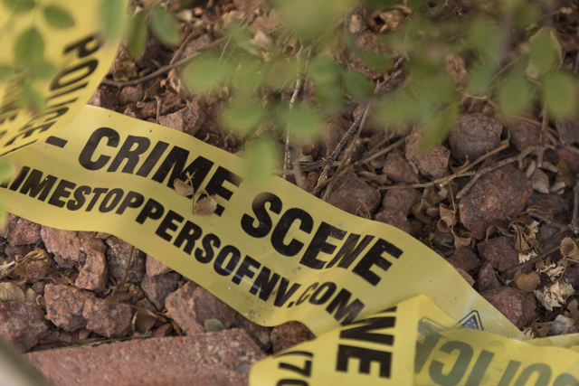 Crime scene tape is seen outside the home of Wednesday night's quadruple murder-suicide victims at Torrey Pines Condominiums in Las Vegas on Saturday, July 2, 2016. Jason Ogulnik/Las Vegas Review- ...