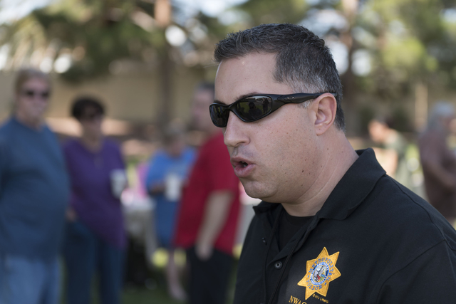 Las Vegas police Lieutenant Nicholas Farese speaks with a reporter during an outreach event held at Torrey Pines Condominiums following Wednesday night's quadruple murder-suicide of a family in La ...