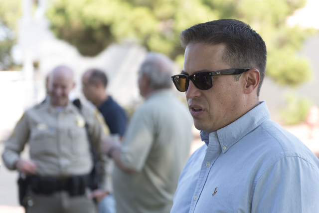 Pastor Matt Teis of Liberty Baptist Church speaks with a reporter during an outreach event held at Torrey Pines Condominiums following Wednesday night's quadruple murder-suicide of a family in Las ...