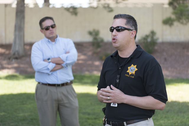 Las Vegas police Lieutenant Nicholas Farese, right, speaks to attendees during an outreach event held at Torrey Pines Condominiums following Wednesday night's quadruple murder-suicide of a family  ...