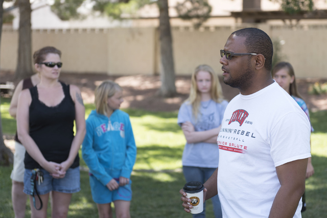 """Bryan Smith, right, sings """"Amazing Grace"""" to attendees of an outreach event held at Torrey Pines Condominiums following Wednesday night's quadruple murder-suicide of a family in  ..."""