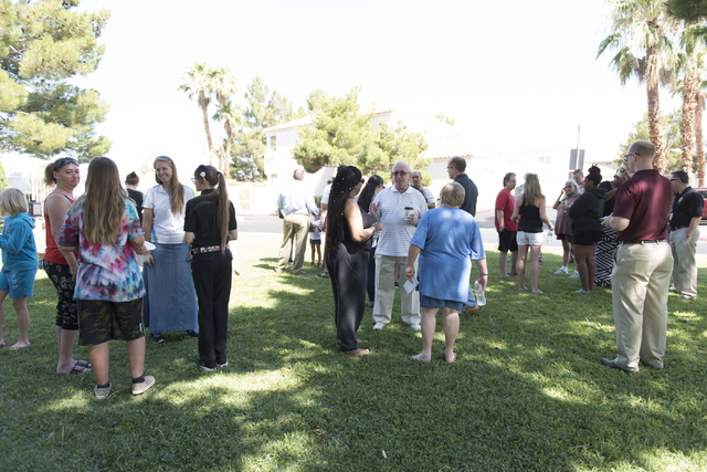 Attendees gather at an outreach event held at Torrey Pines Condominiums following Wednesday night's quadruple murder-suicide of a family in Las Vegas on Saturday, July 2, 2016. Jason Ogulnik/Las V ...