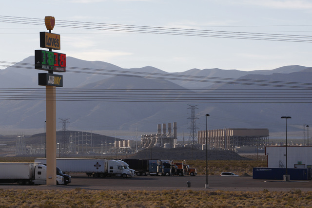 NV Energy's Chuck Lenzie Generating Station is seen behind the Love's Travel Stop that anchors the Apex Commercial Center North section of the Apex Industrial Park Thursday, Oct. 23, 2014. (Sam Mo ...
