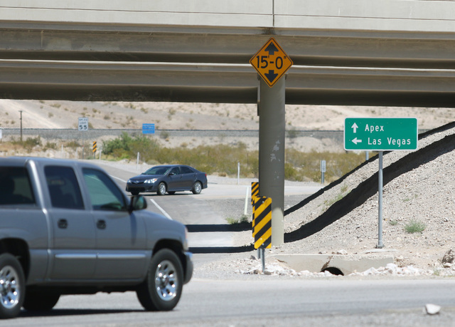 A sign for Apex Industrial Park is shown near the end of an Interstate 15 exit ramp, Thursday, July 21, 2016, in North Las Vegas. (Ronda Churchill/Las Vegas Review-Journal)