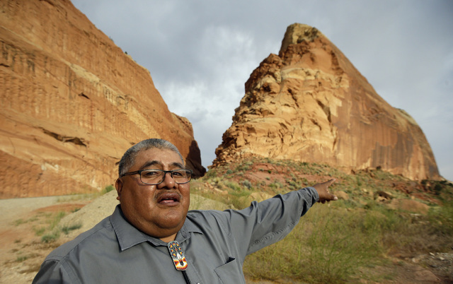 Malcolm Lehi, a Ute Mountain Tribal Commissioner, points to a rock formation near Blanding, Utah, on June 21. (Rick Bowmer/The Associated Press)