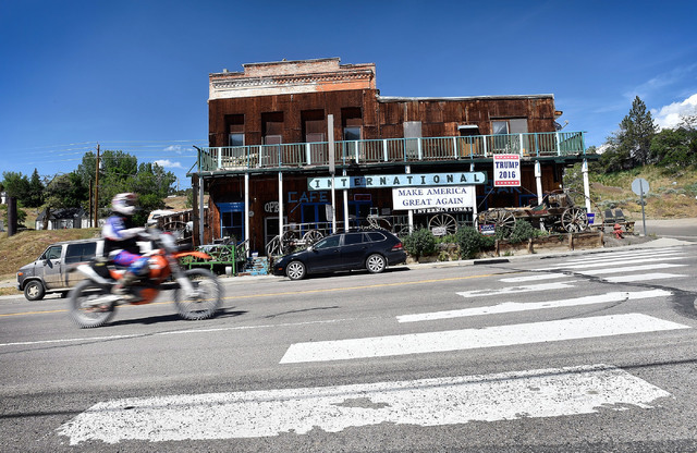 A motorcyclist rides by the International Cafe & Bar Wednesday, June 8, 2016, in Austin, Nev. Owners Victor Antic and Gail Morehead are proud supporters of Republican presidential candidate Do ...