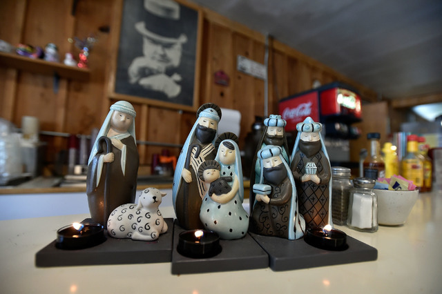 Religious figurines and candles are displayed for customers to see at the International Cafe & Bar Wednesday, June 8, 2016, in Austin, Nev. Owners Victor Antic and Gail Morehead are proud supp ...