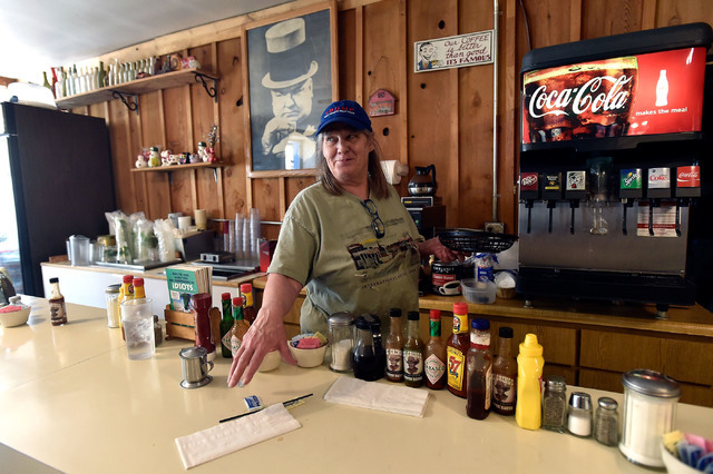 Gail Morehead collects dirty dishes from the lunch counter at the International Cafe & Bar Wednesday, June 8, 2016, in Austin, Nev. Morehead and her partner Victor Antic are proud supporters o ...