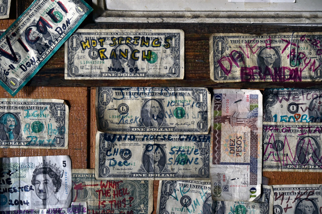 Pieces of currency, including U.S. dollars, British pounds and Cuban pesos are displayed on the walls at the International Cafe & Bar Wednesday, June 8, 2016, in Austin, Nev. David Becker/Las  ...
