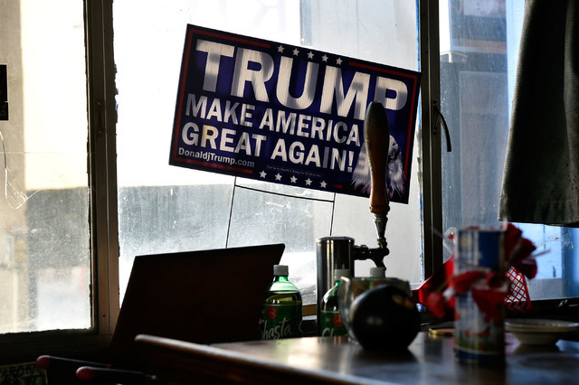A Trump yard sign is placed in the window at the International Cafe & Bar Wednesday, June 8, 2016, in Austin, Nev. Owners Victor Antic and Gail Morehead are proud supporters of the Republican  ...