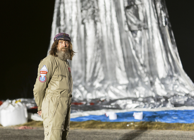 Russian adventurer Fedor Konyukhov stands by his helium and hot-air balloon being inflated before liftoff last week on his record attempt to fly solo in a balloon around the world nonstop in North ...