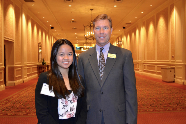 Southwest Career and Technical Academy graduate Marcelle Cruzado, left, celebrates May 18, 2016, with Bank of Nevada Executive Vice President Regional President Michael Cunningham her achievement  ...
