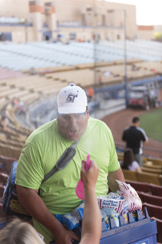 79c1074dda7 A fan sprays hawker Bruce Reiner with water prior to a Las Vegas 51s  baseball game