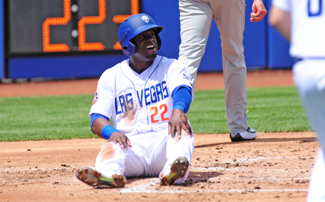 Las Vegas 51s base runner Roger Bernadina reacts after being tagged out at home plate by Albuquerque catcher Nick Hundley in the first inning of their Triple-A minor league baseball game. (Josh Ho ...