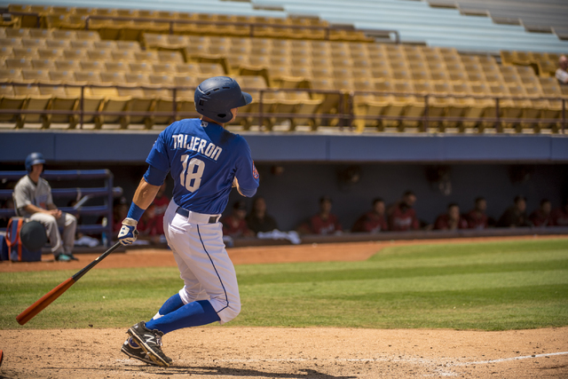 Las Vegas 51s right fielder Travis Taijeron (18) follows through on a swing against the Sacramento River Cats at Cashman Field in Las Vegas on Tuesday, June 28, 2016. Joshua Dahl/Las Vegas Review- ...