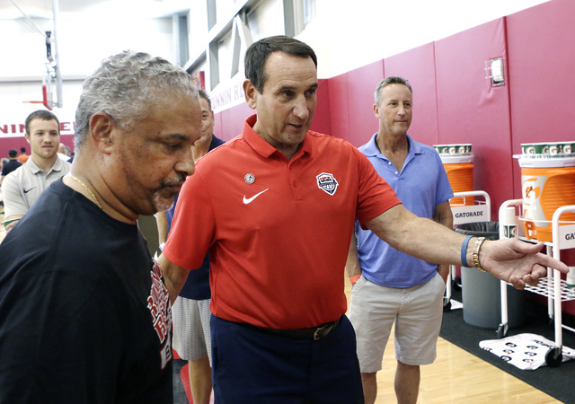 UNLV coach Marvin Menzies, left, and Duke's Mike Krzyzewski, arrive at a press conference at UNLV Mendenhall Center on Thursday, July 21, 2016. Menzies and Krzyzewski talked about their 2016 seaso ...
