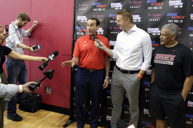Duke's Mike Krzyzewski speaks during a press conference at UNLV Mendenhall Center on Thursday, July 21, 2016, as UNLV coach Marvin Menzies, right, looks on. Krzyzewski and Menzies talked about the ...