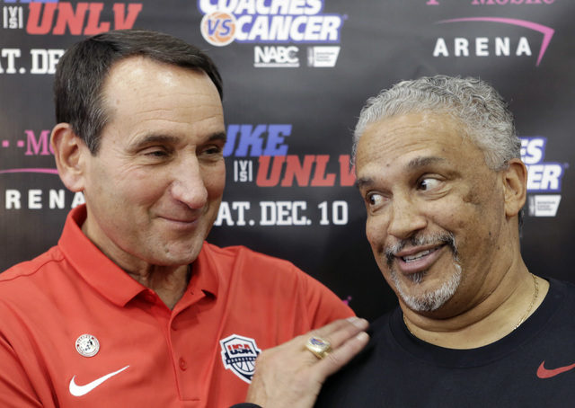 Duke's Mike Krzyzewski, left, shares a moment with UNLV coach Marvin Menzies after a press conference at UNLV Mendenhall Center on Thursday, July 21, 2016. (Bizuayehu Tesfaye/Las Vegas Review-Jour ...