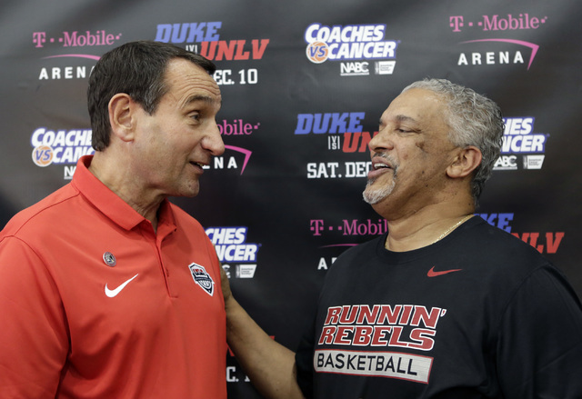 Duke's Mike Krzyzewski, left, shares a moment with UNLV coach Marvin Menzies after a press conference at UNLV Mendenhall Center on Thursday, July 21, 2016. Krzyzewski and Menzies talked about thei ...