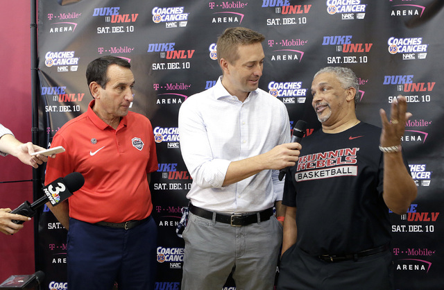 Duke's Mike Krzyzewski, left, listens as UNLV coach Marvin Menzies, right, speaks during a press conference at UNLV Mendenhall Center on Thursday, July 21, 2016. Krzyzewski and Menzies talked abou ...