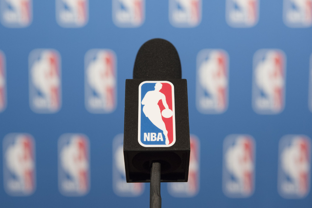 A NBA branded microphone is seen at the podium prior to NBA Commissioner Adam Silver speaking to news media at the Encore hotel-casino Las Vegas on Tuesday, July 12, 2016. Jason Ogulnik/Las Vegas  ...