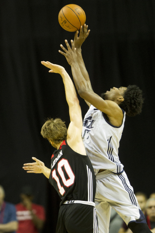 Utah Jazz Quincy Ford (17) makes a shot as he is fouled by Portland Trail Blazers Jake Leyman (10) during the NBA Summer League at the Thomas and Mack Center on Tuesday, July 12, 2016, in Las Vega ...